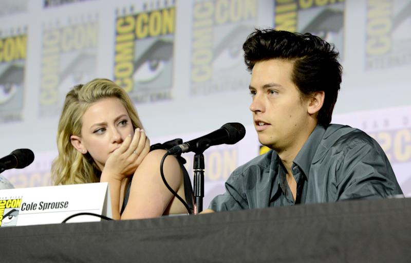 """SAN DIEGO, CALIFORNIA - JULY 21: Lili Reinhart and Cole Sprouse speak at the """"Riverdale"""" Special Video Presentation and Q&A during 2019 Comic-Con International at San Diego Convention Center on July 21, 2019 in San Diego, California. (Photo by Albert L. Ortega/Getty Images)"""