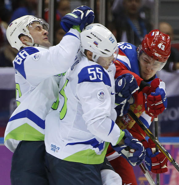 Slovenia defenseman Sabahudin and forward Robert Sabolic collide with Russia forward Valeri Nichushkin in the second period of a men's ice hockey game at the 2014 Winter Olympics, Thursday, Feb. 13, 2014, in Sochi, Russia. (AP Photo/Julio Cortez)