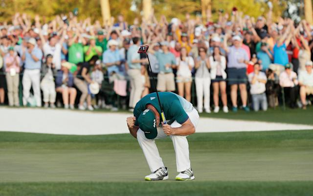 <span>Sergio Garcia sinks to his knees after sealing the 2017 Masters in a play-off</span> <span>Credit: AP </span>