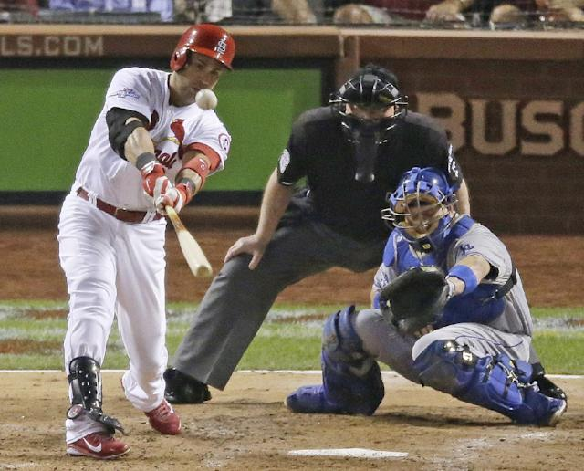 St. Louis Cardinals' Carlos Beltran hits a two-run scoring double during the third inning of Game 1 of the National League baseball championship series against the Los Angeles Dodgers, Friday, Oct. 11, 2013, in St. Louis. (AP Photo/Chris Carlson)