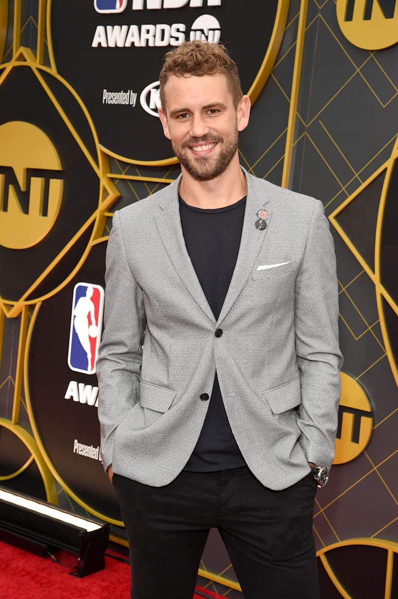 Nick Viall rocks a grey suit and black pant, and he looks incredible