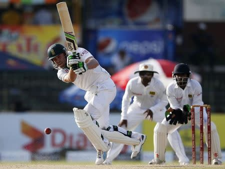 South Africa's de Villiers plays a shot next to Sri Lanka's wicketkeeper Dickwella and Jayawardene during the second day of their second test cricket match in Colombo