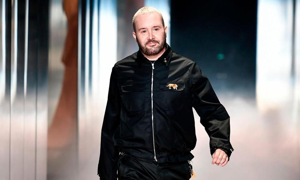Kim Jones walks the runway after presenting his Fendi spring-summer collection.