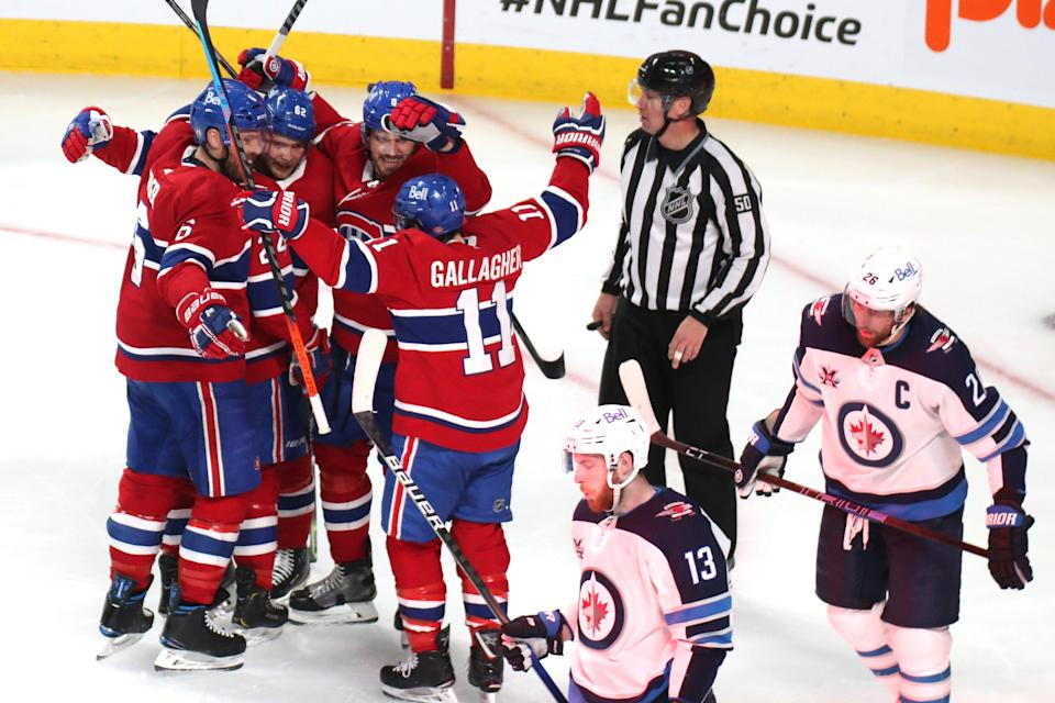 The Montreal Canadiens celebrate a Game 3 goal against the Winnipeg Jets.