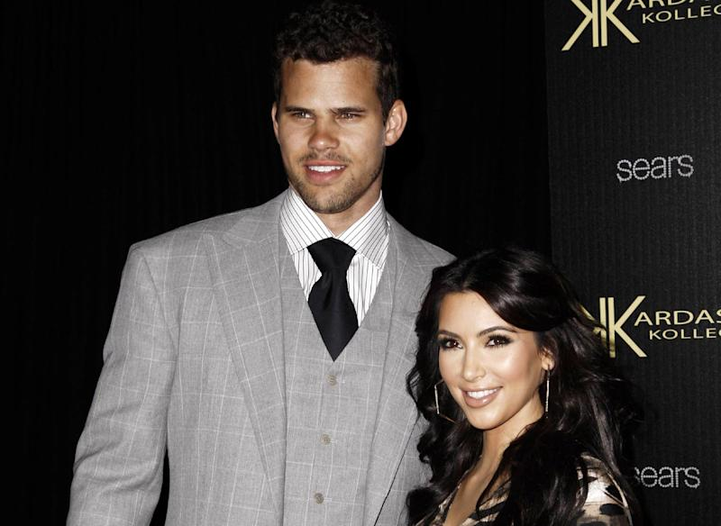 FILE - In this Aug. 17, 2011 file photo, reality TV personality Kim Kardashian, right, and her fiance, NBA basketball player Kris Humphries, arrive at the Kardashian Kollection launch party in Los Angeles. Kardashian's divorce attorney told a judge Friday, May 4, 2012, that she believes Humphries' hurt feelings about the marriage are slowing down the case and that it could get very expensive for the NBA player if he continues to pursue his claims the couple's nuptials were a fraud. Humphries filed for an annulment of the couple's 72-day marriage on Thursday in Los Angeles. (AP Photo/Matt Sayles, file)