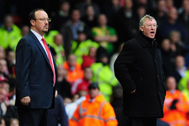 LIVERPOOL, UNITED KINGDOM - OCTOBER 25: Manchester United Manager Sir Alex Ferguson shouts from the touch line as Liverpool Manager Rafael Benitez (L) looks on during the Barclays Premier League match between Liverpool and Manchester United at Anfield on October 25, 2009 in Liverpool, England. (Photo by Clive Mason/Getty Images)