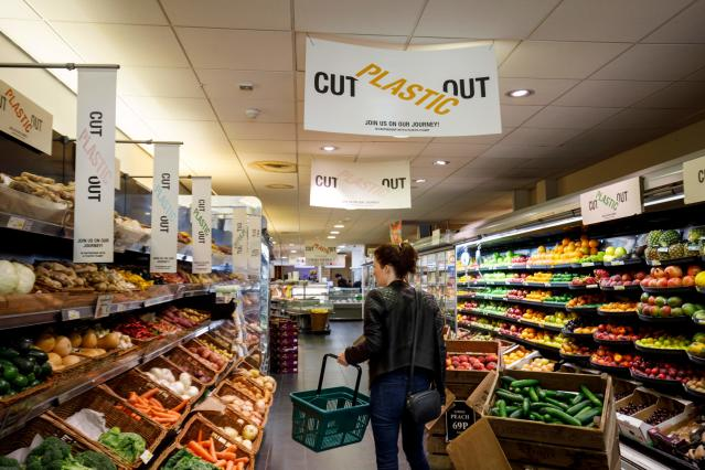 Signs promoting plastic-packaging free products at Budgens supermarket in Belsize Park, north London. Photo: Tolga Akmen/AFP/Getty