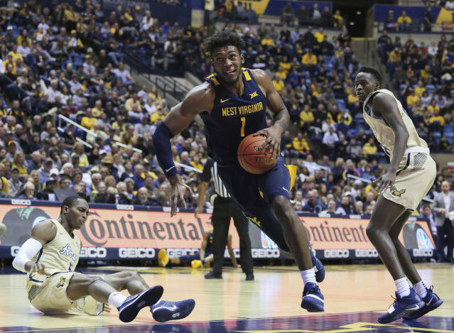 West Virginia's Derek Culver goes to shoot against Akron during the second half of an NCAA college basketball game, Friday, Nov. 8, 2019, in Morgantown, W.Va. (AP Photo/Kathleen Batten)