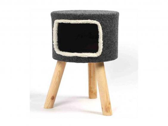 Minimise the cat hair on your carpet with this bed that's held on wooden legs (Pet Planet)