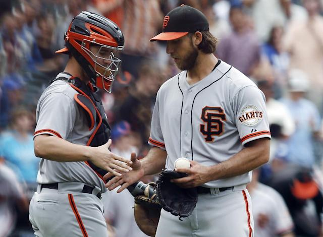 San Francisco Giants catcher Andrew Susac, left, congratulates starting pitcher Madison Bumgarner after Bumgarner threw a 9-0, complete-game shutout against the New York Mets in a baseball game in New York, Sunday, Aug. 3, 2014. (AP Photo/Kathy Willens)