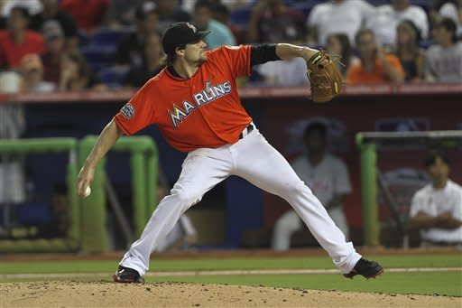 Miami Marlins starter Nathan Eovaldi (24) pitches to the Philadelphia Phillies during the third inning of a MLB baseball game in Miami, Sunday, Sept. 30, 2012. (AP Photo/J Pat Carter)