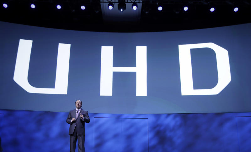 Samsung Electronics America Executive Vice President Joe Stinziano introduces a 105-inch ultra high definition curved television during a news conference at the International Consumer Electronics Show, Monday, Jan. 6, 2014, in Las Vegas. (AP Photo/Isaac Brekken)