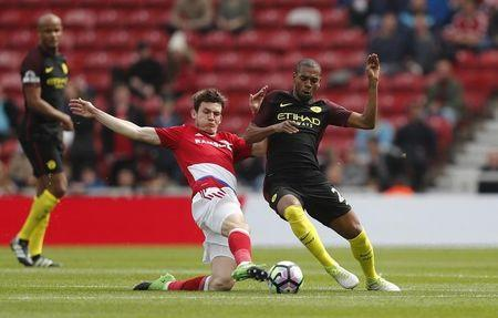 Britain Football Soccer - Middlesbrough v Manchester City - Premier League - The Riverside Stadium - 30/4/17 Manchester City's Fernandinho in action with Middlesbrough's Marten De Roon Reuters / Russell Cheyne Livepic