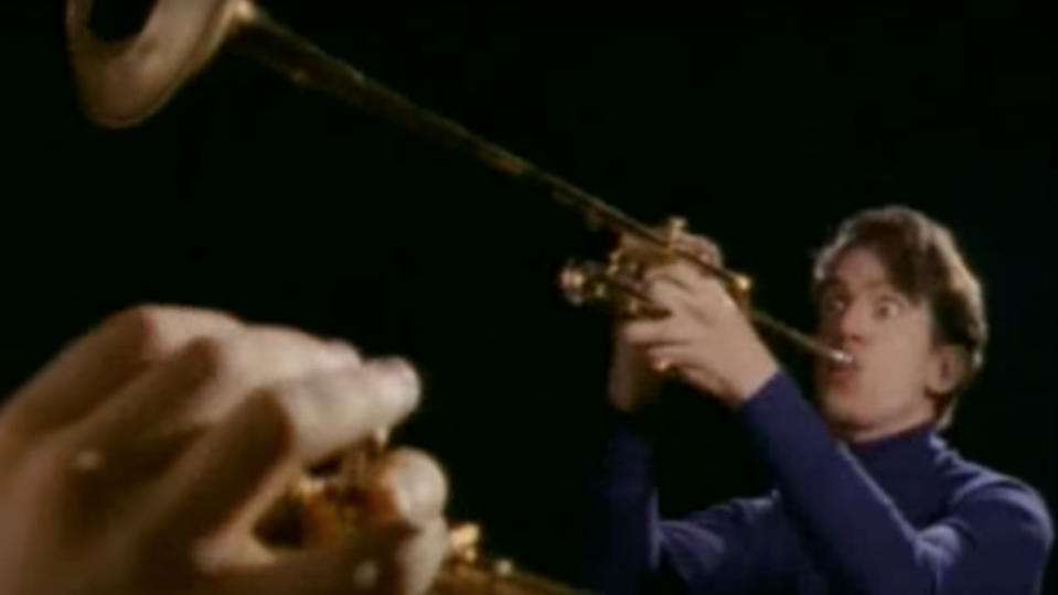 """They Might Be Giants plays horns in the video for """"Birdhouse in Your Soul"""""""