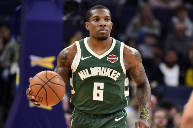 After colliding with Wesley Matthews on Friday night, Bucks point guard Eric Bledsoe will miss at least two weeks with a right leg injury. (AP/Brandon Dill)