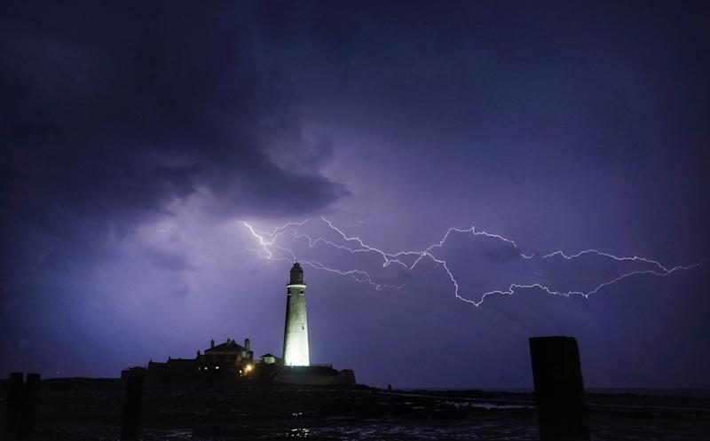 Lightning strikes near St Mary's Lighthouse in Whitley Bay, north east England, as more rain and thunderstorms brought further flood warnings across the UK. Picture date: Monday August 5, 2019. See PA story WEATHER Rain. Photo credit should read: Owen Humphreys/PA Wire (Photo by Owen Humphreys/PA Images via Getty Images)
