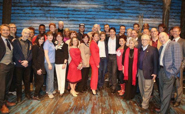 """Prime Minister Justin Trudeau and wife Sophie Gregoire Trudeau pose backstage with the cast and crew of the hit musical """"Come from Away"""" on Broadway at The Schoenfeld Theatre on March 15, 2017 in New York City."""