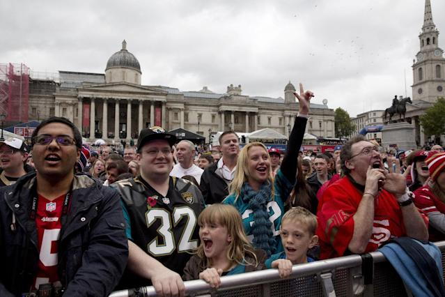 Fans cheers the goings on, during an NFL fan rally in Trafalgar Square, London, Saturday, Oct. 26, 2013. The San Francisco 49ers are due to play the the Jacksonville Jaguars at Wembley stadium in London on Sunday, Oct. 27 in a regular season NFL game. (AP Photo/Matt Dunham)