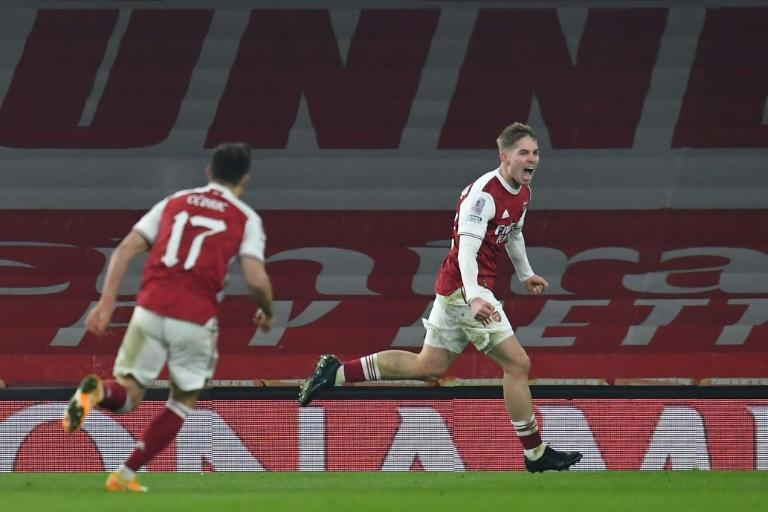 Arsenal midfielder Emile Smith Rowe (right) celebrates his winning goal against Newcastle in the FA Cup