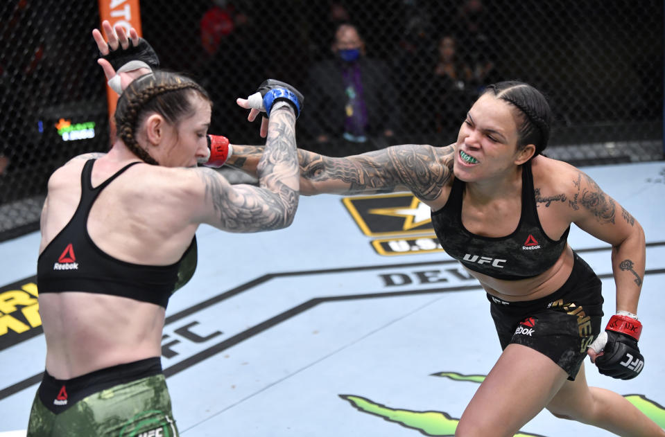 LAS VEGAS, NEVADA - MARCH 06: (R-L) Amanda Nunes of Brazil punches Megan Anderson of Australia in their UFC featherweight championship fight during the UFC 259 event at UFC APEX on March 06, 2021 in Las Vegas, Nevada. (Photo by Jeff Bottari/Zuffa LLC)