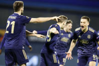 Dinamo Zagreb's Mislav Orsic, center, celebrates with his teammates after scoring his side's second goal during the Europa League round of 16 second leg soccer match between Dinamo Zagreb and Tottenham Hotspur at the Maksimir stadium in Zagreb, Croatia, March 18, 2021. (AP Photo/Darko Bandic)