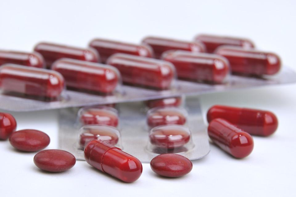 assortment of red pills and capsules of iron supplements