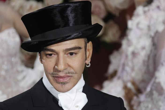 British designer John Galliano acknowledges the audience following the Christian Dior spring-summer 2010 haute couture collection show on January 25, 2010 (AFP Photo/Francois Guillot)