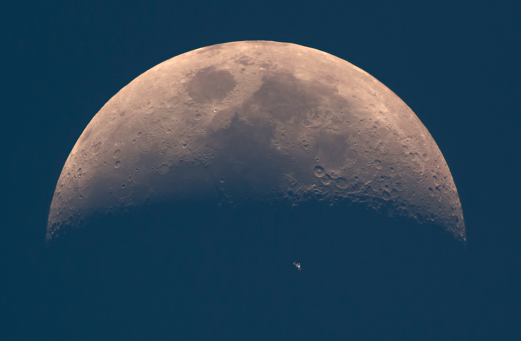 <p>The International Space Station (ISS) whizzes across the dusky face of the Earth's natural satellite, the Moon, whilst photographed in broad daylight. (Pic: Dani Caxete) </p>