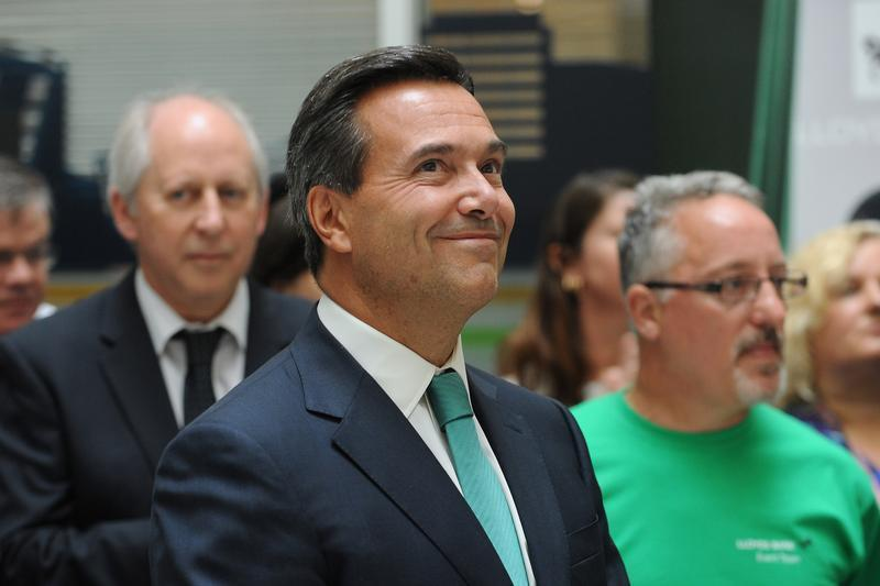 Lloyds Banking Group chief executive Antonio Horta-Osorio listens to Britain's Chancellor of the Exchequer George Osborne address staff at a Lloyds Contact Centre in Birmingham