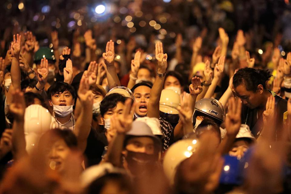 People show the three-fingered salute during a protest, in Bangkok, Thailand October 26, 2020. / Credit: SOE ZEYA TUN / REUTERS