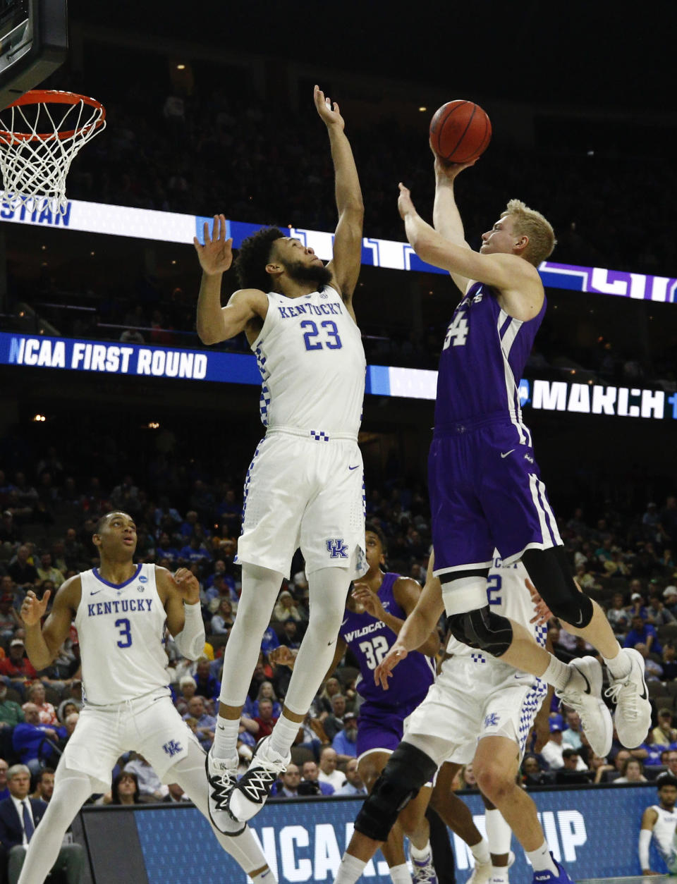 Abilene Christian's Kolton Kohl, right, goes up for a shot against Kentucky's EJ Montgomery (23) during the first half of a first-round game in the NCAA mens college basketball tournament in Jacksonville, Fla. Thursday, March 21, 2019. (AP Photo/Stephen B. Morton)
