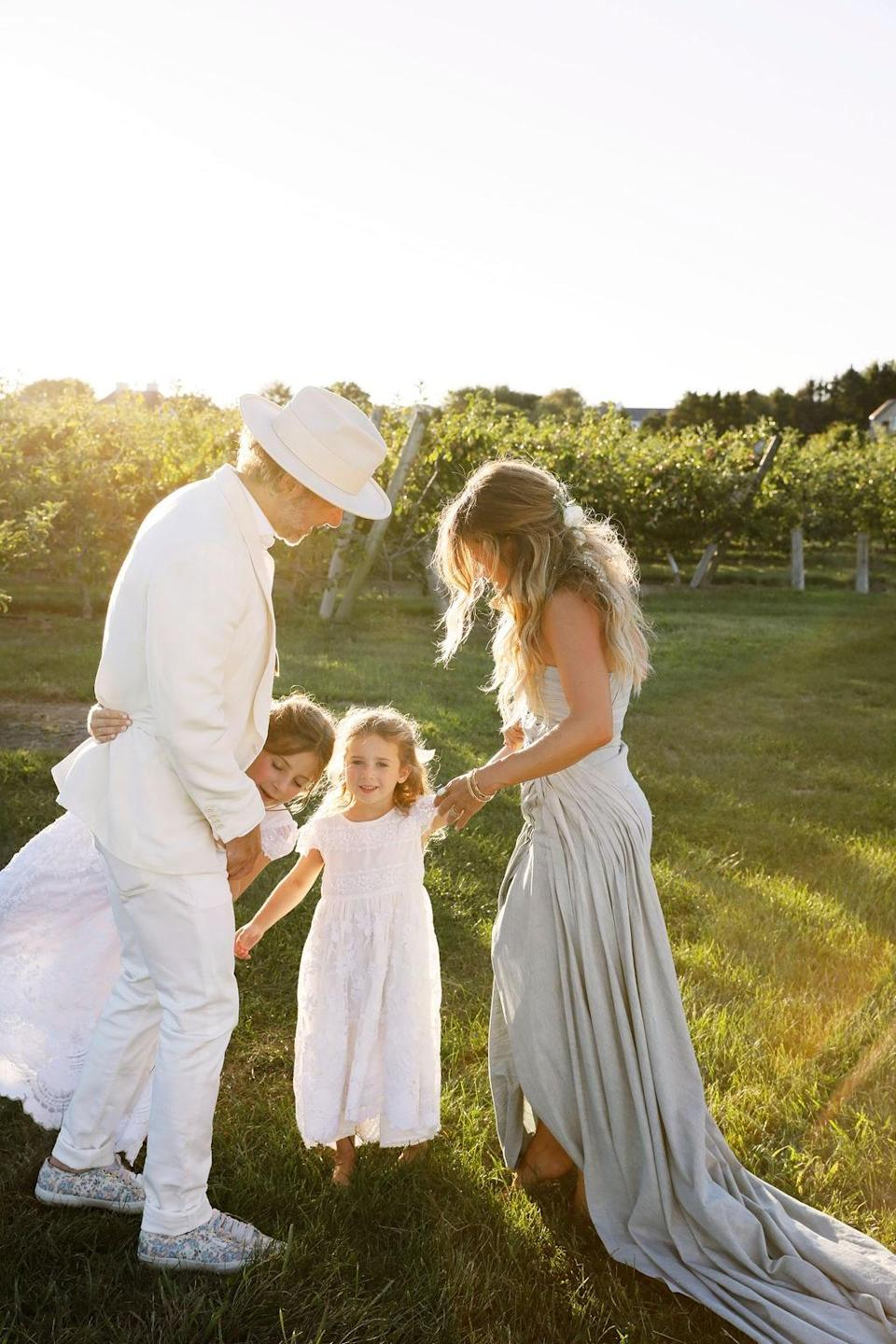 """""""Friends that are family,"""" Dean notes. """"Todd Cohen and his girls, Stella, Scarlett, and Rebecca Hessel Cohen dancing barefoot at the edge of the apple orchards."""""""