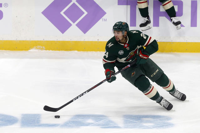 FILE - In this Nov. 27, 2018, file photo, Minnesota Wild's Matt Dumba skates with the puck durng an NHL hockey game against the Arizona Coyote in St. Paul, Minn. The Wild have taken an extra edge to the ice this fall because of it, buoyed by the return from injury by center Mikko Koivu and defenseman Matt Dumba.v(AP Photo/Jim Mone, File