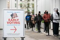 In Atlanta on Dec. 14, 2020, Georgians line up to vote in the Senate runoff election.