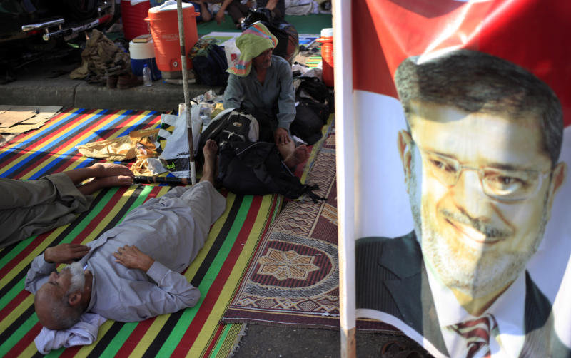 Supporters of ousted President Mohammed Morsi rest at their encampment in Nasr City in Cairo, Egypt, Thursday, July 18, 2013. Pro-Morsi protesters continued their sit-in in front of Rabaah al-Adawiya Mosque in Cairo for the third week. Residents of the area have complained blocking the roads and using nearby gardens for washing and sewage purposes. (AP Photo/Khalil Hamra)