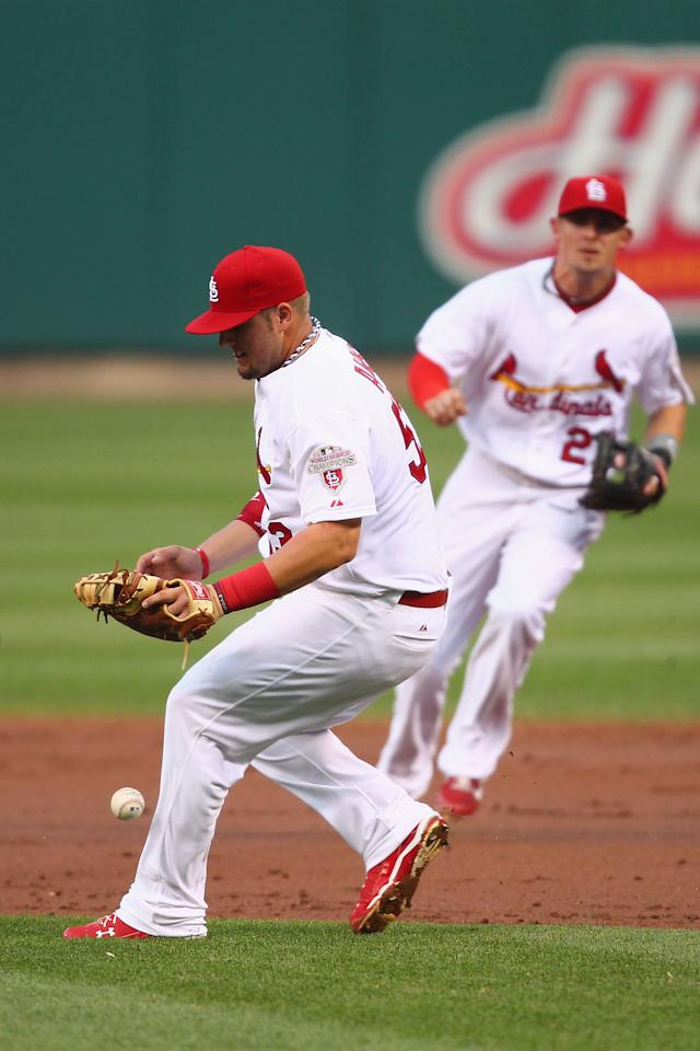 ST. LOUIS, MO - MAY 25: Matt Adams #53 of the St. Louis Cardinals misplays a ground ball to allow a run against the Philadelphia Phillies at Busch Stadium on May 25, 2012 in St. Louis, Missouri.  (Photo by Dilip Vishwanat/Getty Images)