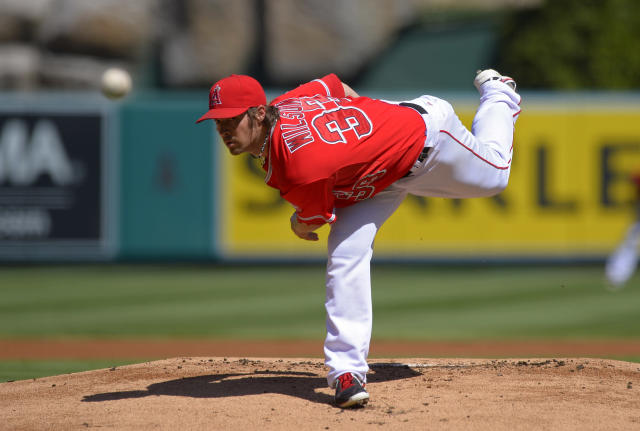 Los Angeles Angels starting pitcher C.J. Wilson throws to the plate during the first inning of a baseball game against the Seattle Mariners, Sunday, Sept. 22, 2013, in Anaheim, Calif. (AP Photo/Mark J. Terrill)