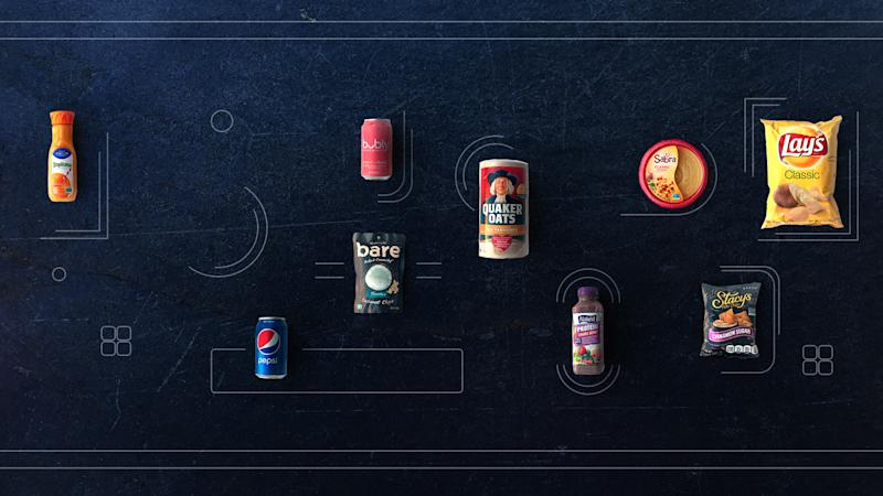 PepsiCo products arranged on a dark grey surface.