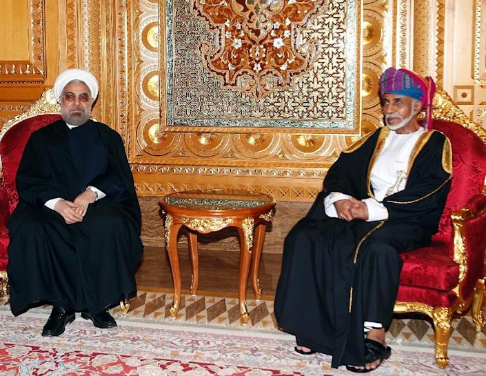 Omani leader Sultan Qaboos bin Said (right) and Iranian President Hassan Rouhani sit during a welcome ceremony in Muscat on March 12, 2014 (AFP Photo/Mohammed Mahjoub)