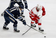 Detroit Red Wings forward Sam Gagner, right, chases the puck in front of Columbus Blue Jackets forward Kevin Stenlund during the second period of an NHL hockey game in Columbus, Ohio, Friday, May 7, 2021. (AP Photo/Paul Vernon)