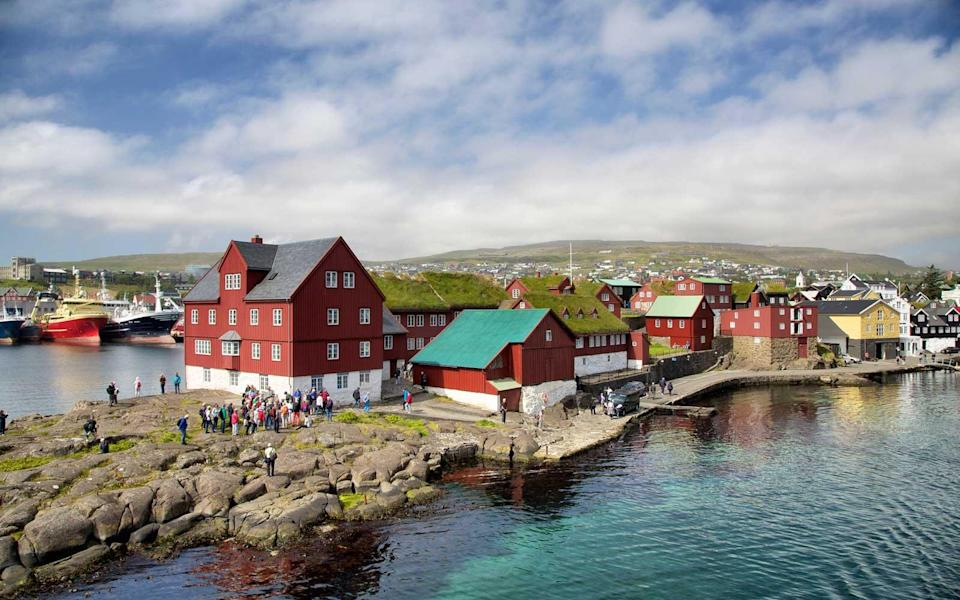 """<p>This archipelago in the North Sea doesn't often get a mention as a Northern Lights destination, but at 62° N (it's about halfway between Scotland and Iceland) it gets plenty of aurora action. If you need another excuse to visit this """"jewel of the Atlantic,"""" its tiny, charming capital city <a rel=""""nofollow noopener"""" href=""""https://www.torshavn.com/v/festivals"""" target=""""_blank"""" data-ylk=""""slk:Tórshavn"""" class=""""link rapid-noclick-resp"""">Tórshavn</a> holds a Winter Jazz Festival from January 25–28, 2018.</p>"""
