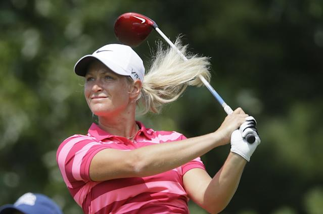 Suzann Pettersen, of Norway, drives on the third hole during the third round of the Meijer LPGA Classic golf tournament at Blythefield Country Club, Saturday, Aug. 9, 2014, in Belmont, Mich. (AP Photo/Carlos Osorio)