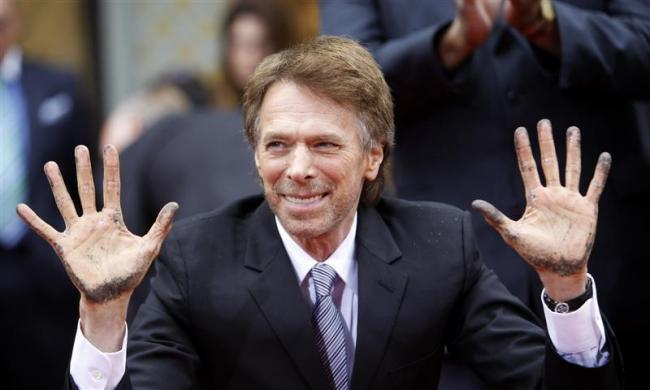 Jerry Bruckheimer, $115 million: Jerry Bruckheimer shows off his hands after leaving his handprints in cement at the Grauman's Chinese theatre in Hollywood, California May 17, 2010.