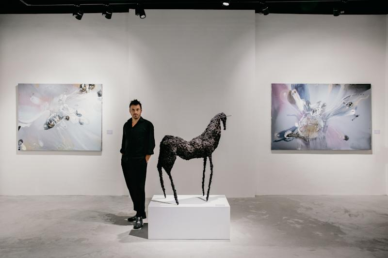 Lionel Sabatté, French contemporary artist with his art sculpture at Cuturi Gallery in Singapore. (PHOTO: Cuturi Gallery)