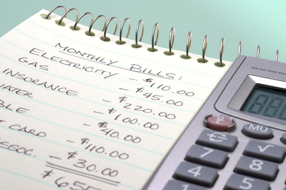 Adding up the monthly bills (Photo: tacojim via Getty Images)