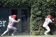 St. Louis Cardinals left fielder Tyler O'Neill (27) and center fielder Harrison Bader (48) can't catch a three-run double hit by Chicago Cubs' Kris Bryant (17) during the seventh inningof a baseball game, Friday, July 9, 2021, in Chicago. (AP Photo/David Banks)