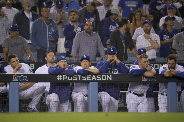 Members of the Los Angeles Dodgers react to the team's 7-3 loss to the Washington Nationals in Game 5 of a baseball National League Division Series on Wednesday, Oct. 9, 2019, in Los Angeles. (AP Photo/Mark J. Terrill)