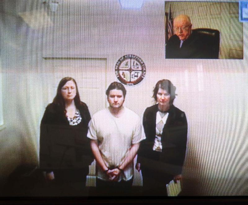 "Seth Mazzaglia, bottom center, is seen during his video arraignment from the Strafford County jail in Dover, N.H. to the district court in Dover  Monday, Oct. 15, 2012. Mazzaglia was charged with killing Elizabeth ""Lizzi"" Marriott, a 19-year-old University of New Hampshire student. (AP Photo/Jim Cole)"