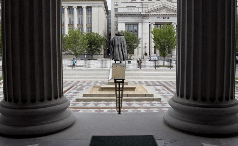 FILE - In this Aug. 17, 2010 file photo, a statue of the Albert Gallatin, the 4th Secretary of the Treasury, stands on the north patio of the US Treasury Building in Washington. Fear and uncertainty about the global economy are leading investors to embrace the relative safety of U.S. government debt and slashing yields to record lows. Interest paid on the 10-year Treasury note reached 1.38 percent late Tuesday, July 5, 2016, just below the previous record set in 2012. (AP Photo/Pablo Martinez Monsivais, File)