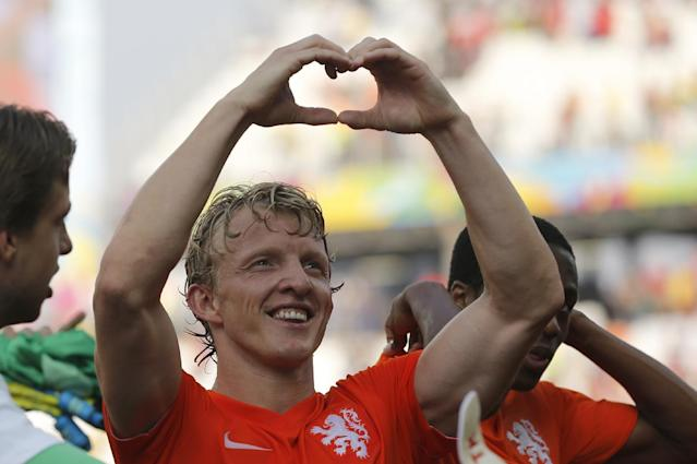 Netherlands' Dirk Kuyt forms a heart with his hands after the group B World Cup soccer match between the Netherlands and Chile at the Itaquerao Stadium in Sao Paulo, Brazil, Monday, June 23, 2014. The Dutch team beat Chile 2-0 to top Group B. (AP Photo/Frank Augstein)